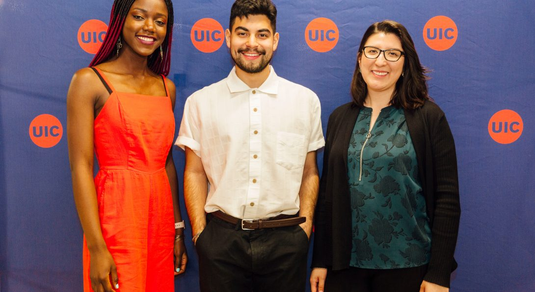UPPF Program mentors stand in front of UIC backdrop